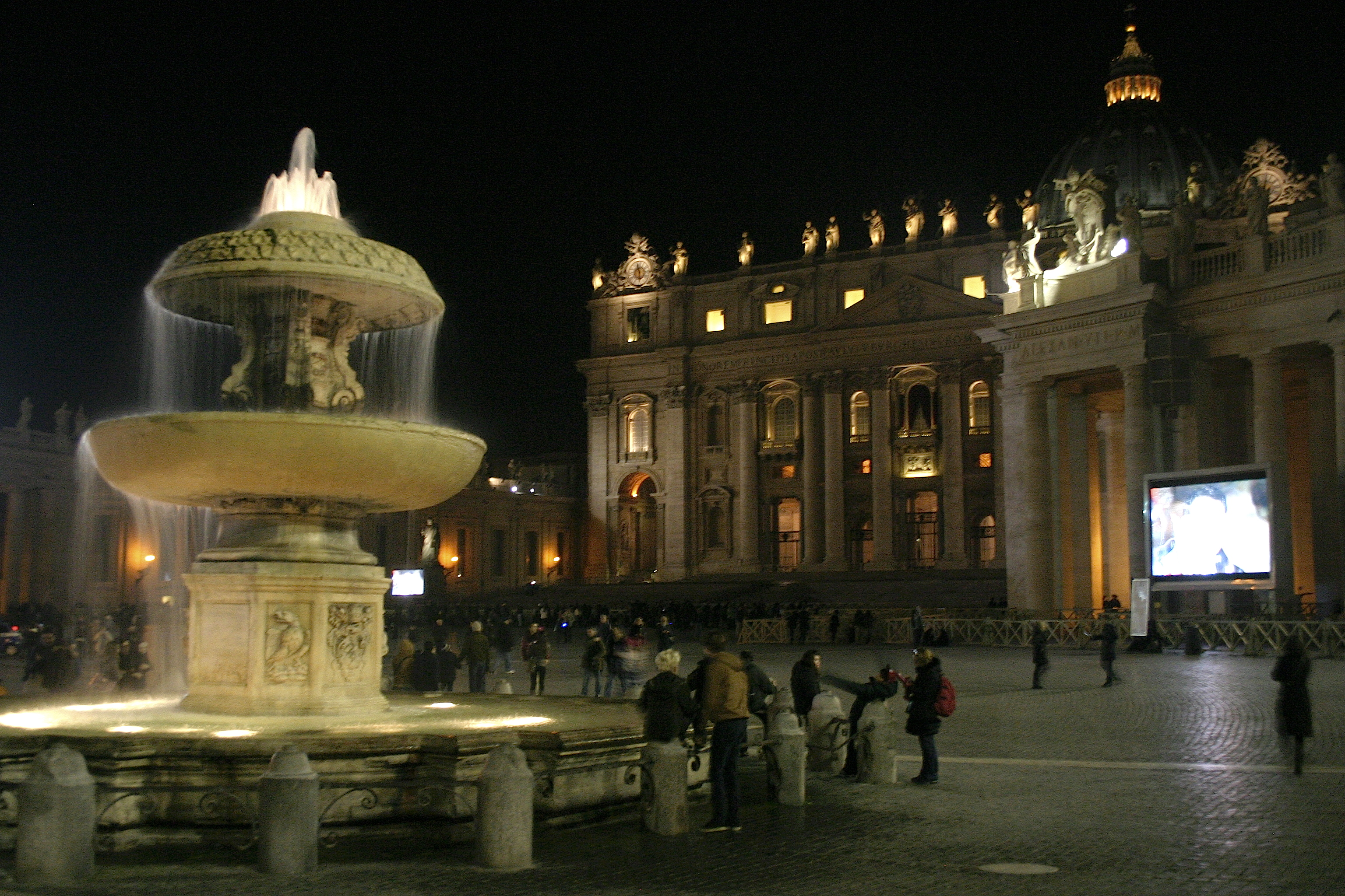 Vatican st peter square at night with fountain